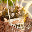 Stock Photo: Artificial flower in bicycle basket
