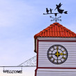 Stock Photo: Angle and kids - weathervane on top of roof
