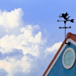 Stock Photo: Cupid on weathervane and blue sky