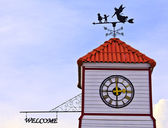 Angle and kids - weathervane on the top of roof — Stock Photo