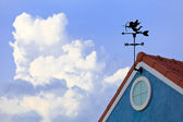 Cupid on weathervane and blue sky — Stock Photo