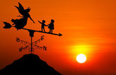 Weather vane at sunset — Stock Photo