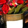 Ref flowers in metal basket — Stock Photo