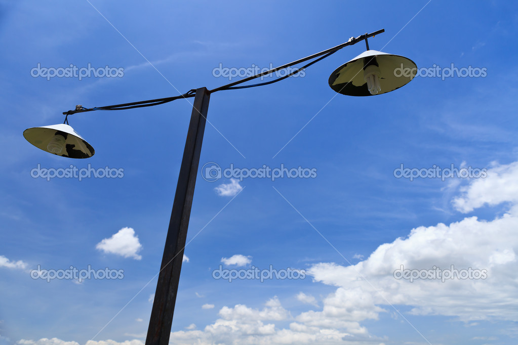 Old style street lamp and blue sky — Stock Photo #11584817