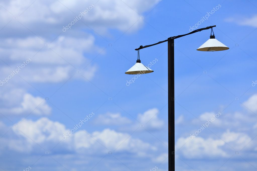 Old style street lamp and blue sky  Stock Photo #11585230
