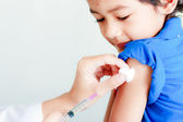 Boy and vaccine syringe — Stock Photo