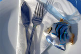 Table decoration on the beach. Sea air & adventure.Cutlery — Stock Photo
