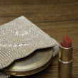 Hot Red Lipstick, beaded pearl purse and antique powder compact — Stock Photo