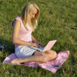 Girl with pink netbook — Stock Photo