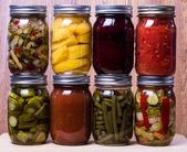 Group of fresh homemade preserved vegetables and fruits — Stock Photo
