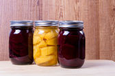 Jars of preserved fruit — Stock Photo