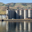 Grain elevator storage on river — Stock Photo