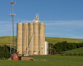 Concrete grain silos with cell phone tower — Stock Photo