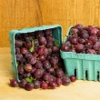 Fresh red gooseberries on wooden table — Stock Photo