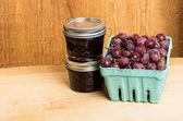 Gooseberry jam and red gooseberries — Stock Photo