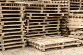 Pallets stacked ready for use — Stockfoto