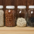 Stock Photo: Beans in glass canisters in kitchen