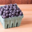 Постер, плакат: Container of ripe blueberries
