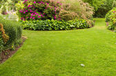 Lawn with flower garden — Stockfoto