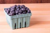 Blueberries in container on table — Stock Photo