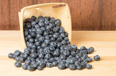 Blueberries in wooden container — Stock Photo