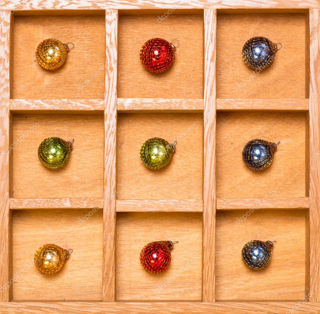 Shadow box with Christmas ornaments arranged by color green — Stock Photo #12122141