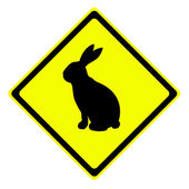 Rabbit in warning traffic sign — Stock Photo