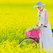 Foto Stock: Womand bicycle