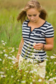 Wild flowers and girl — Stock Photo