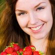 Girl and strawberries — Stock Photo