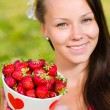 Stock Photo: Girl and strawberries