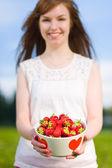 Girl and strawberries — Stock Photo