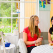 Chatting in porch — Stock Photo