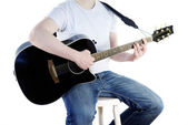 Young musician with a guitar — Stock Photo