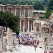 Ephesus, near Izmir, Turkey Tourists in front of the library of Celsius — Stock Photo #11347474