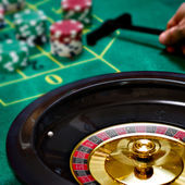 Playing roulette with a moving roulette — Stock Photo