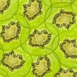 Fresh juicy kiwi fruit slice background — Stock Photo