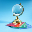 Glass globe with credit cards — Stock Photo