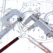 Stock Photo: Micrometer, Caliper, Mechanical Pencil and Compass on Blueprint