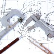 Micrometer, Caliper, Mechanical Pencil and Compass on Blueprint — Stock Photo