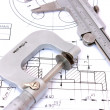 Stock Photo: Caliper and Micrometer on blueprint vertical