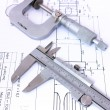 Stock Photo: Micrometer and caliper on blueprint vertical