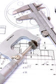 Caliper and Micrometer on blueprint vertical — Stock Photo