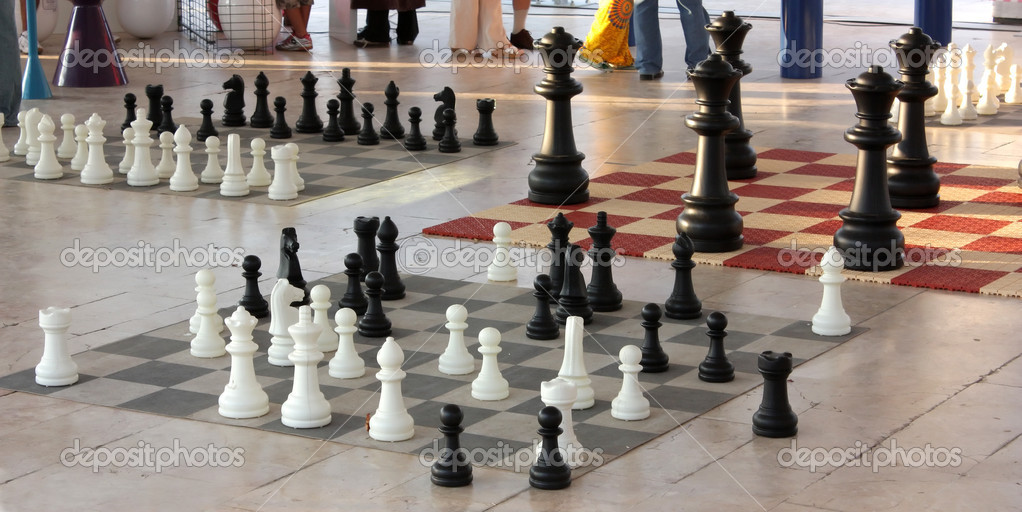 Chess pieces in diferent size on a chess boards  Stock Photo #11922517