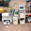 Old computer parts and electronic junk in flea market — Stock Photo #11963778