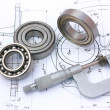 Stock Photo: Ball bearings with micrometer on technical drawing