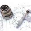 Stock Photo: Three ball bearings over and over with micrometer on technical d