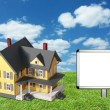 Stock Photo: Model house on green grass with blank sign