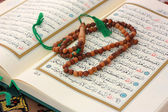 Holy Quran with wooden rosary — Stock Photo