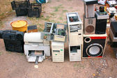Old computer parts and electronic junk in flea market — Stock Photo